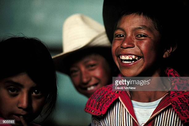 Mayan children laugh with the photographer during a party to celebrate the arrival of elecricity to a small settlement near Todos Santos Cuchumatan...