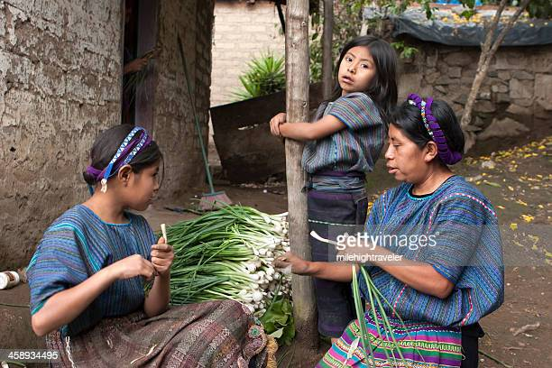 Mayan family cleaning onions Lake Atitlan Guatemala