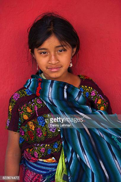 Mayan girl in colorful traditional dress in Antigua