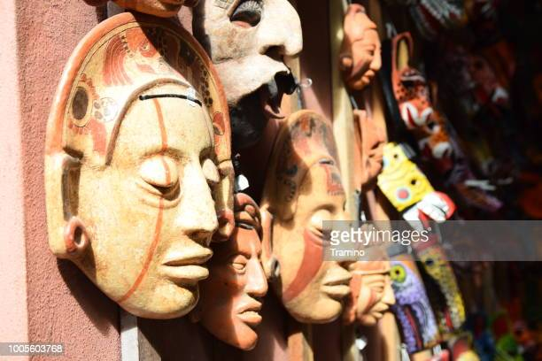 mayan masks on the bazaar - central america stock pictures, royalty-free photos & images