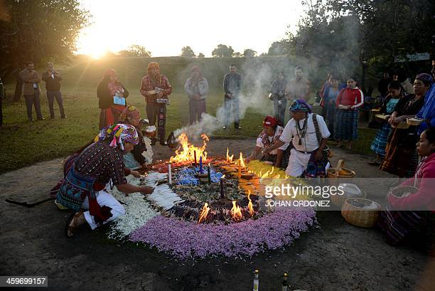 Mayan priests celebrate a ceremony at the archaeological site of Kaminal Juyu in Guatemala City on December 29 2013 during the activities marking the...