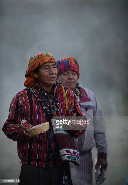 Mayan priests celebrate a Mayan ceremony at the archaeological site of Kaminal Juyu in Guatemala City on December 29 2013 during the activities...