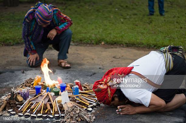 Mayan priests take part in a Mayan ceremony celebrating the 'International Day of the World's Indigenous Peoples' on August 9 2012 at the Kaminal...