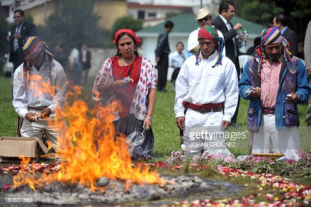 Mayan priests takes part in a Mayan ceremony celebrating the 'International Day of Indigenous Peoples' on August 9 2011 at the Kaminal Juyu...