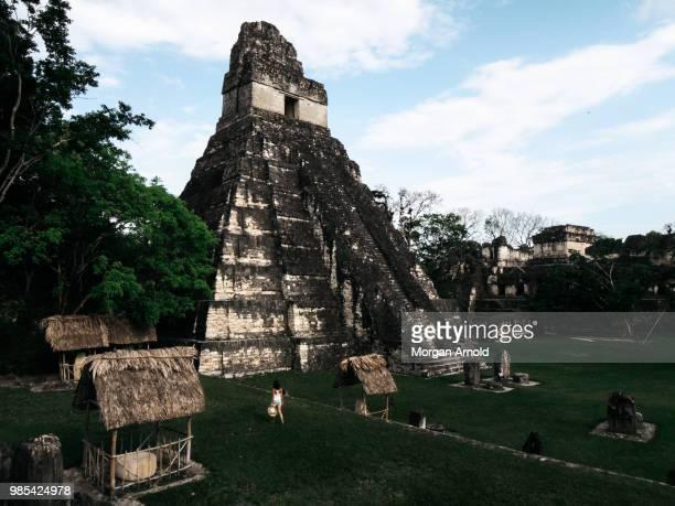 mayan ruins of tikal - mayan people stock photos and pictures