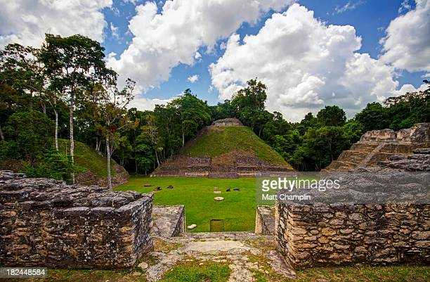 mayan site of caracol pyramids in plaza - belize stock pictures, royalty-free photos & images