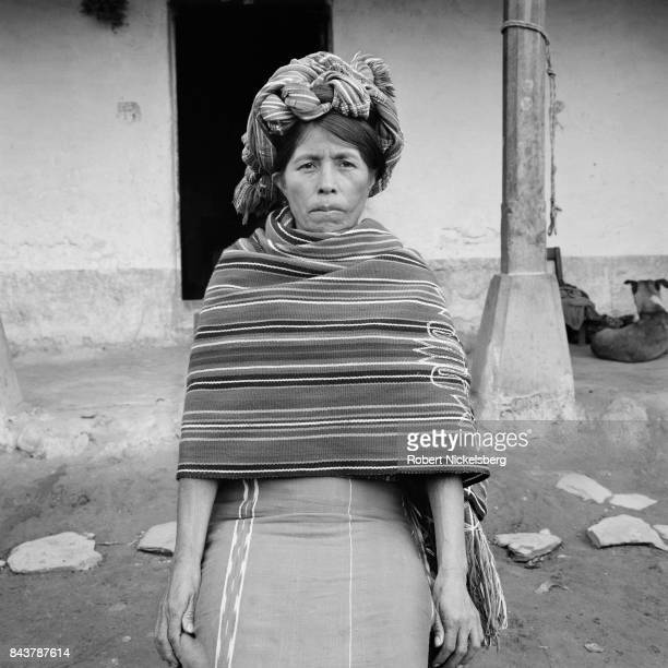 January 1: A Mayan woman wearing a traditional head dress sits for a picture January 1, 1984 in Nebaj, Guatemala. Many residents of the Ixil...