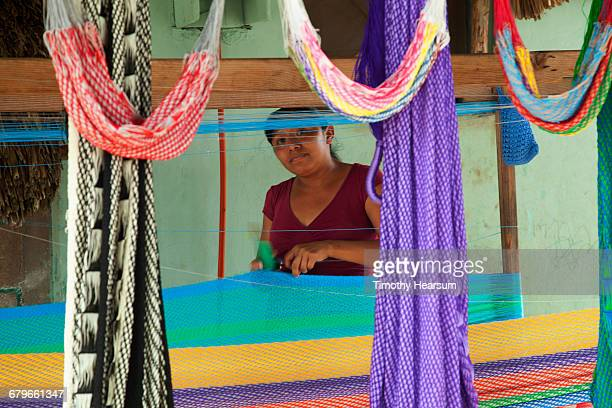 mayan woman weaving a hammock in traditional style - timothy hearsum stock pictures, royalty-free photos & images