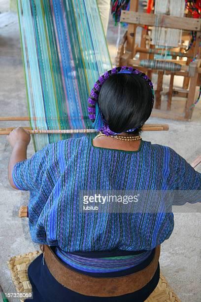 Mayan woman weaving in village by lake Atitlan, Guatemala