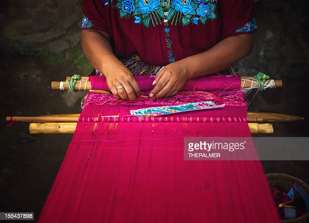 mayan woman weaving on loom - woven stock photos and pictures