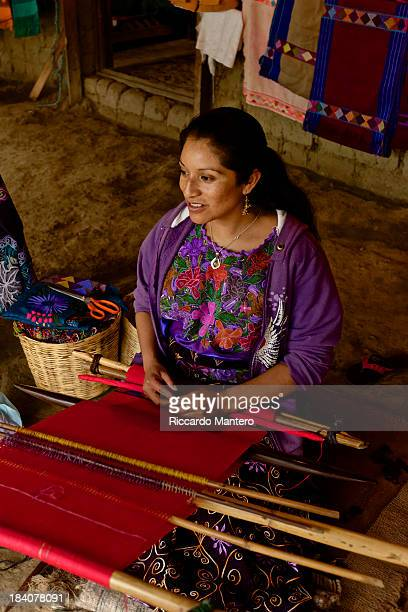 CONTENT] A mayan woman weaving with traditional loom in Chiapas Mexico