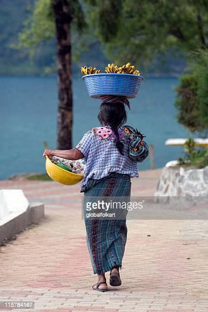 mayan woman with fruit, lake atitlan guatemala - mayan people stock photos and pictures