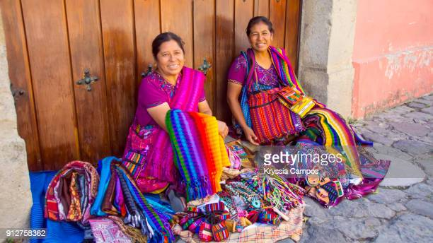 mayan women selling handmade textiles and souvenirs, antigua, guatemala - indigenous culture stock pictures, royalty-free photos & images