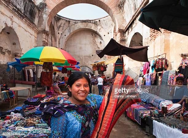 Mayan women working at textile market in Santa Catalina church ruins