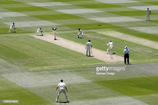 Mayank Agarwal of India hits Nathan Lyon of Australia to the boundary during day one of the Third Test match in the series between Australia and...