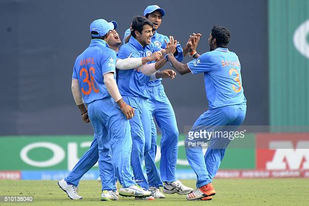 Mayank Dagar of India celebrates the wicket of Jyd Goolie of West Indies U19 during the ICC U19 World Cup Final Match between India and West Indies...