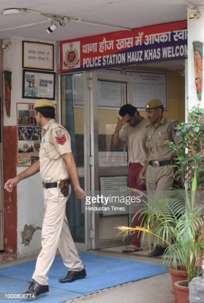 Mayank Singhvi husband of air hostess Anissia Batra is seen being taken to the court from the Hauz Khas police station in New Delhi India on Tuesday...