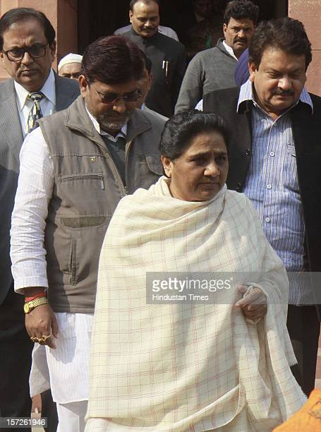 Mayawati head of the Bahujan Samaj Party leaves parliament with her party MP's after attending parliament winter session on November 30 2012 in New...
