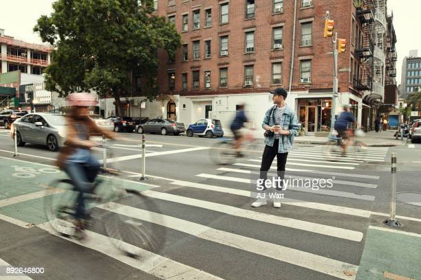 maybe i should get a bicycle too - busy sidewalk stock pictures, royalty-free photos & images