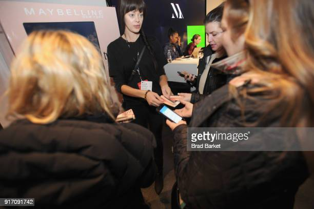 Maybelline brand ambassador hands out Maybelline products from the Maybelline vending machine during IMG NYFW The Shows at Spring Studios on February...