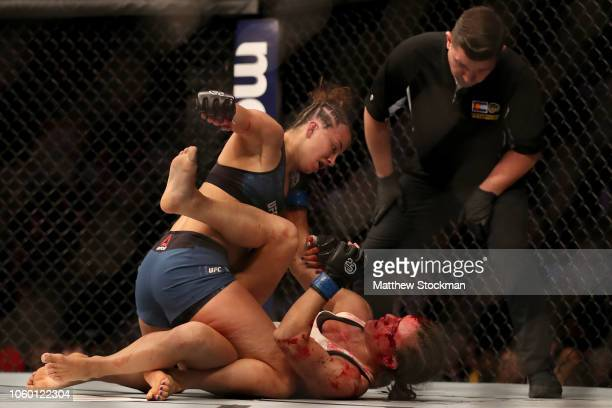 Maycee Barber fights Hannah Cifers in their Women's Strawweight bout during the UFC Fight Night 139 at the Pepsi Center on November 10 2018 in Denver...