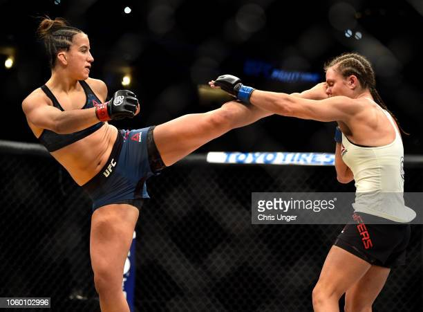 Maycee Barber kicks Hannah Cifers in their women's strawweight bout during the UFC Fight Night event inside Pepsi Center on November 10 2018 in...