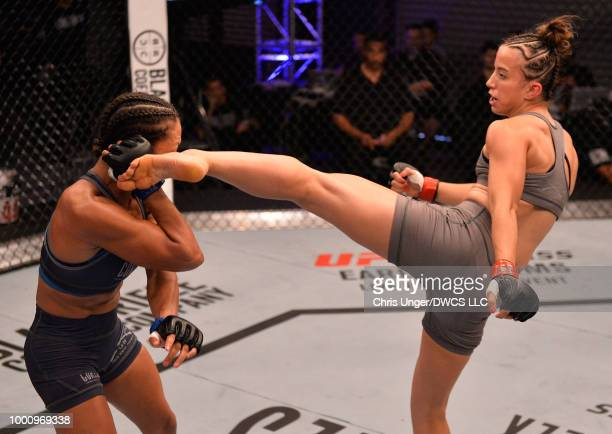 Maycee Barber kicks Jamie Colleen in their womens strawweight fight during Dana White's Tuesday Night Contender Series at the TUF Gym on July 17 2018...
