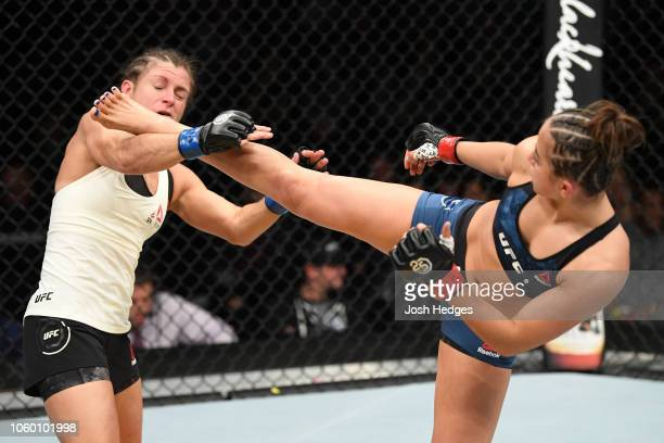 Maycee Barber kicks the head of Hannah Cifers in their women's strawweight bout during the UFC Fight Night event inside Pepsi Center on November 10...