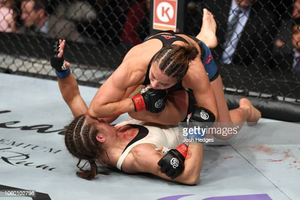 Maycee Barber land an elbow to the head of Hannah Cifers in their women's strawweight bout during the UFC Fight Night event inside Pepsi Center on...