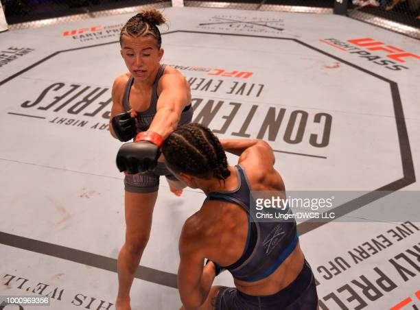 Maycee Barber punches Jamie Colleen in their womens strawweight fight during Dana White's Tuesday Night Contender Series at the TUF Gym on July 17...