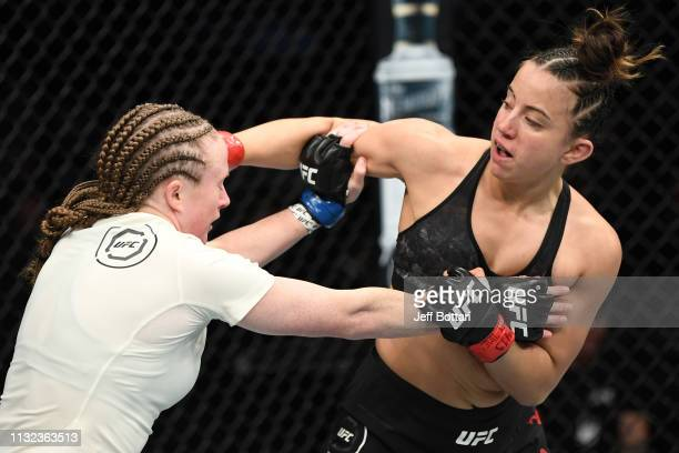 Maycee Barber punches JJ Aldrich in their women's flyweight bout during the UFC Fight Night event at Bridgestone Arena on March 23 2019 in Nashville...