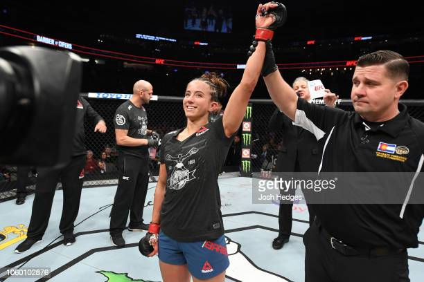 Maycee Barber reacts after defeating Hannah Cifers in their women's strawweight bout during the UFC Fight Night event inside Pepsi Center on November...