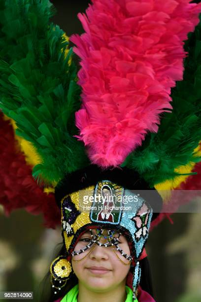 Mayela Flores a dancer with Danza Matachina Guadalupana shows off her spectacular headdress that weighs over 10 lbs outside of the Clyfford Still...
