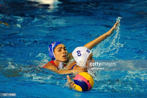 Mayelin Bernal of Cuba is blocked by Luiza Carvalho of Brazil in the Women's Waterpolo bronze medal final match in the 2011 XVI Pan American Games at...