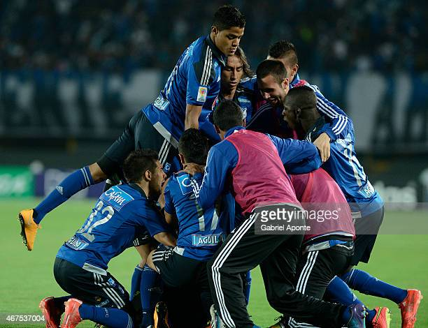 Mayer Candelo of Millonarios celebrates with teammates after scoring the first goal of his team during a match between Millonarios and Deportivo...