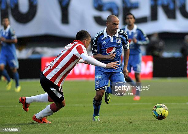 Mayer Candelo of Millonarios FC struggles for the ball with Andres Correa of Atletico Junior during a match between Millonarios FC and Atletico...