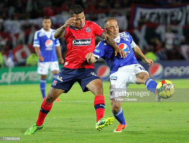 Mayer Candelo of Millonarios struggles fo the ball with Amilcar Henriquez of Independiente Medellin during a match between Millonarios and...