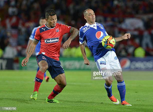Mayer Candelo of Millonarios struggles for the ball with Amilcar Henriquez of Independiente Medellin during a match between Millonarios and...