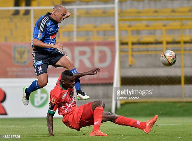Mayer Candelo of Millonarios struggles for the ball with Jesus Murillo of Patriotas FC during a match between Patriotas FC and Millonarios as part of...