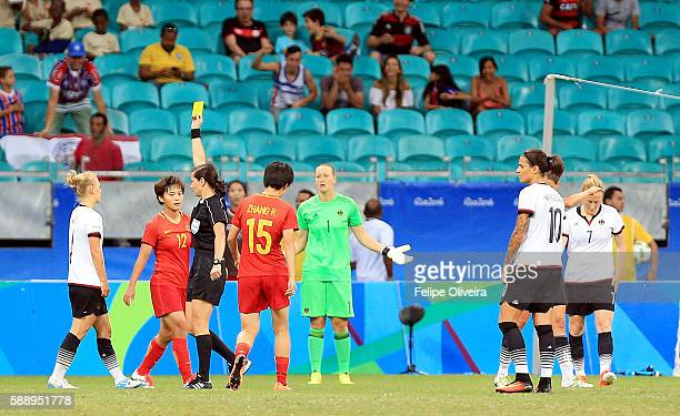 Mayer of Germany given a yellow card during the Women's Football Quarterfinal match at Arena Fonte Nova Stadium on Day 7 of the Rio 2016 Olympic...