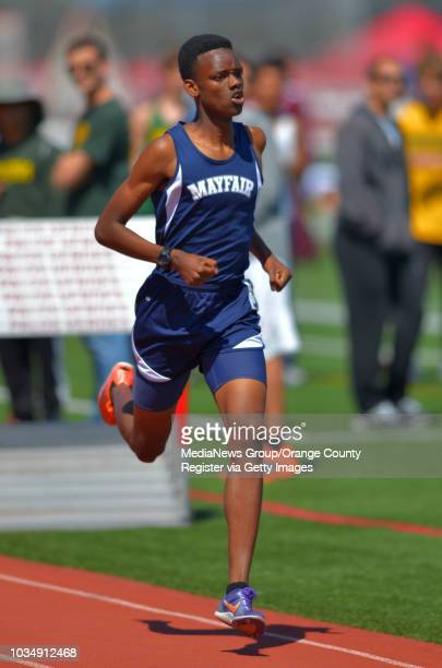 Mayfair's Ellis Newton wins his varsity 1600 meter run in the Palos Verdes Invitational track and field meet in Palos Verdes Estates CA on Saturday...
