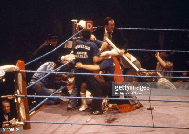 Mayhem during the WBA and WBC World middleweight title fight between Alan Minter of Great Britain and Marvin Hagler of the USA after a spectator...