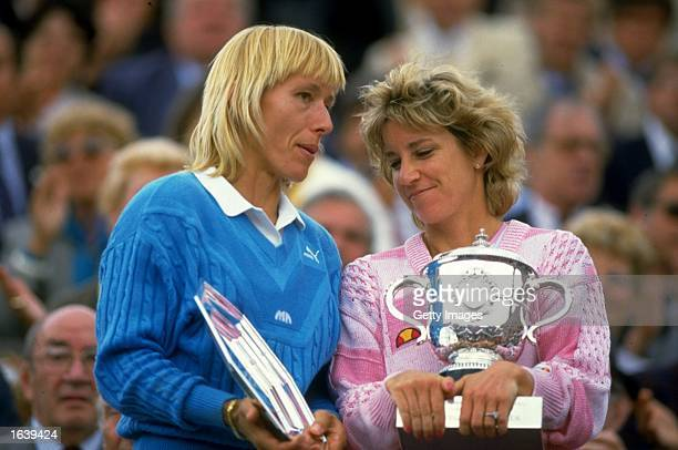 Martina Navratilova of the USA chats with Chris Evert also of the USA as they hold their respective trophies after the Womens Singles final during...
