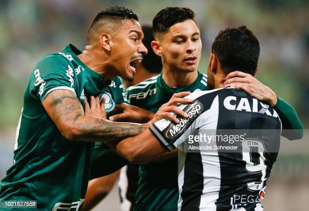 Mayke and Diogo Barbosa of Palmeiras argue with Brenner of Botafogo during the match for the Brasileirao Series A 2018 at Allianz Parque Stadium on...