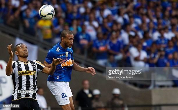 Mayke of Cruzeiro struggles for the ball with Ramirez of Botafogo during a match between Cruzeiro and Botafogo as part of Brasileirao Series A 2014...