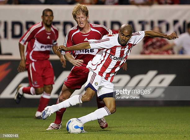 Maykel Galindo of Chivas USA pushes the ball past Jim Curtin of the Chicago Fire on June 9, 2007 at Toyota Park in Bridgeview, Illinois. Chivas USA...