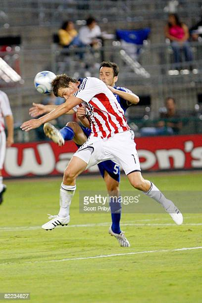 Maykel Galindo of Chivas USA tries to head the ball against Kerry Zavagnin of the Kansas City Wizards during the game at Community America Ballpark...