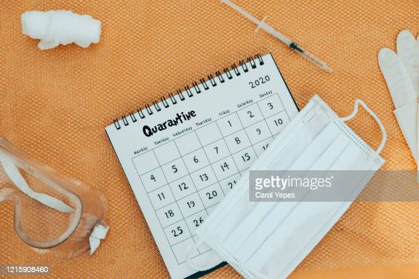 mayl calendar with protective mask.lockdown - month stock pictures, royalty-free photos & images