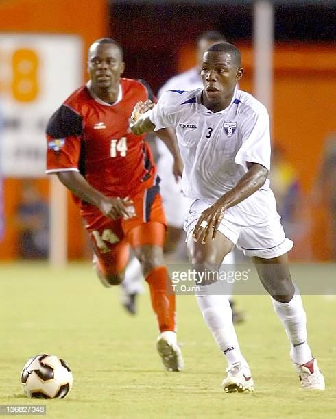 Maynor Figeroa races forward in front of Stern John of Trinidad during a match at the Orange Bowl Miami Florida July 7 2005 The game ended in a 11 tie