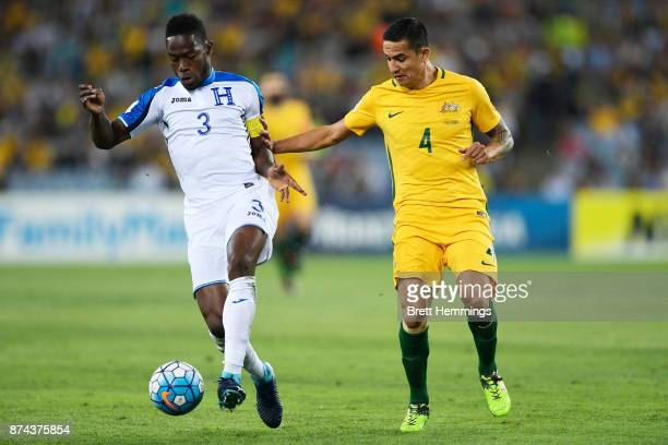 Maynor Figueroa of Honduras controls the ball against Tim Cahill of Australia during the 2018 FIFA World Cup Qualifiers Leg 2 match between the...
